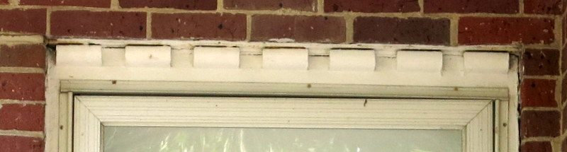 Closeup of dentil on brick home in Greenbelt Homes