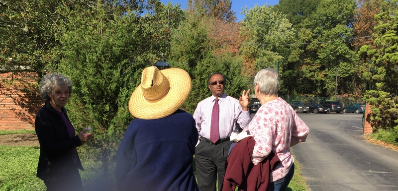GHI General Manager Eldon Ralph discusses landscape with volunteer gardeners