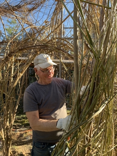 Patrick Dougherty working on stickhouse