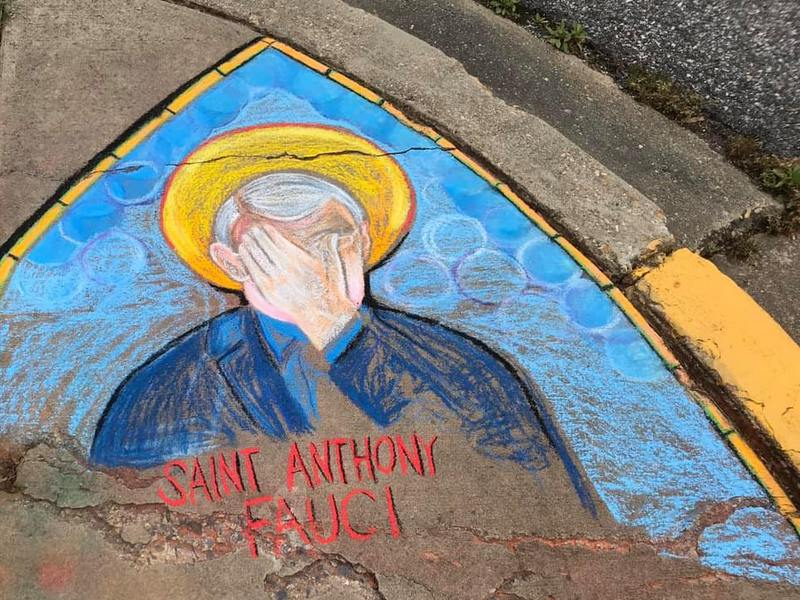 Chalk sidewalk art in Old Greenbelt - Dr. Fauci as Saint.