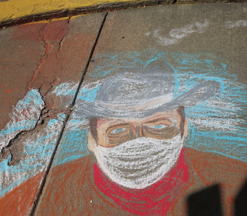Chalk sidewalk art in Old Greenbelt - masked cowboy