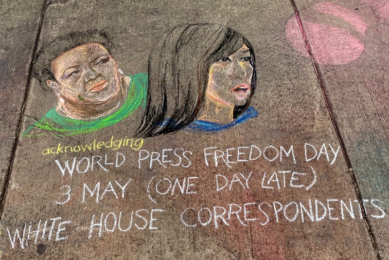 Chalk sidewalk art of Yamiche Alcindor and Weijia Jiang for World Press Freedom Day