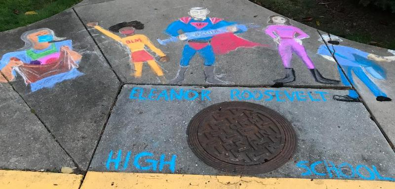 Sidewalk chalk drawings of American Heroes.